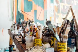making space - pots of used paint brushes