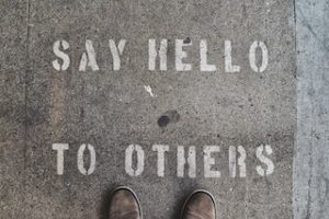 Say hello to others - written on the pavement